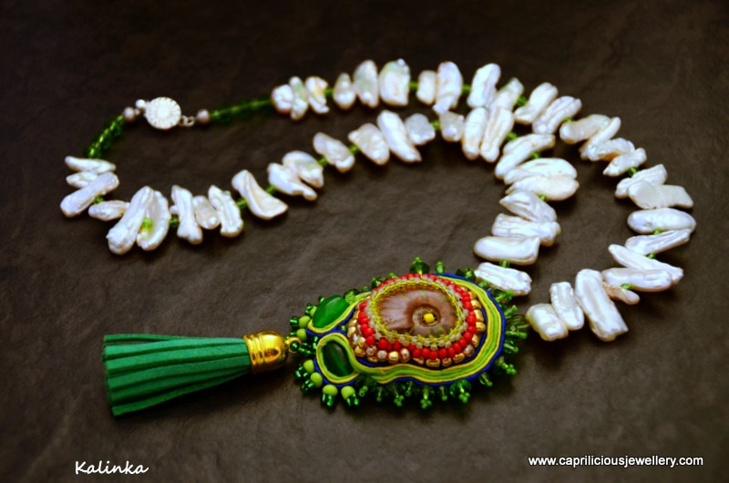 Ammonite fossil pendant, soutache braiding and seed beads ultrasuede tassel on a necklace of Biwa pearls