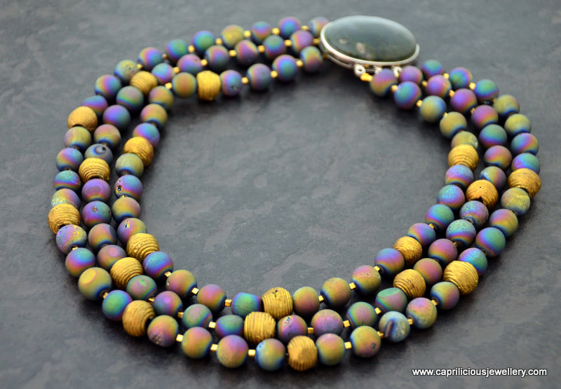 Titanium and gold plated druzy agate beads in a multistrand necklace by Caprilicious Jewellery