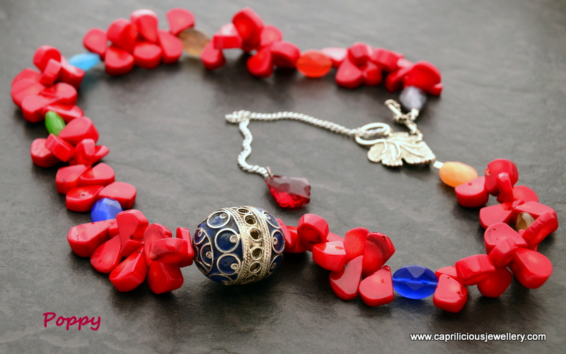 Coral and Moroccan bead necklace with cats eye accents by Caprilicious Jewellery