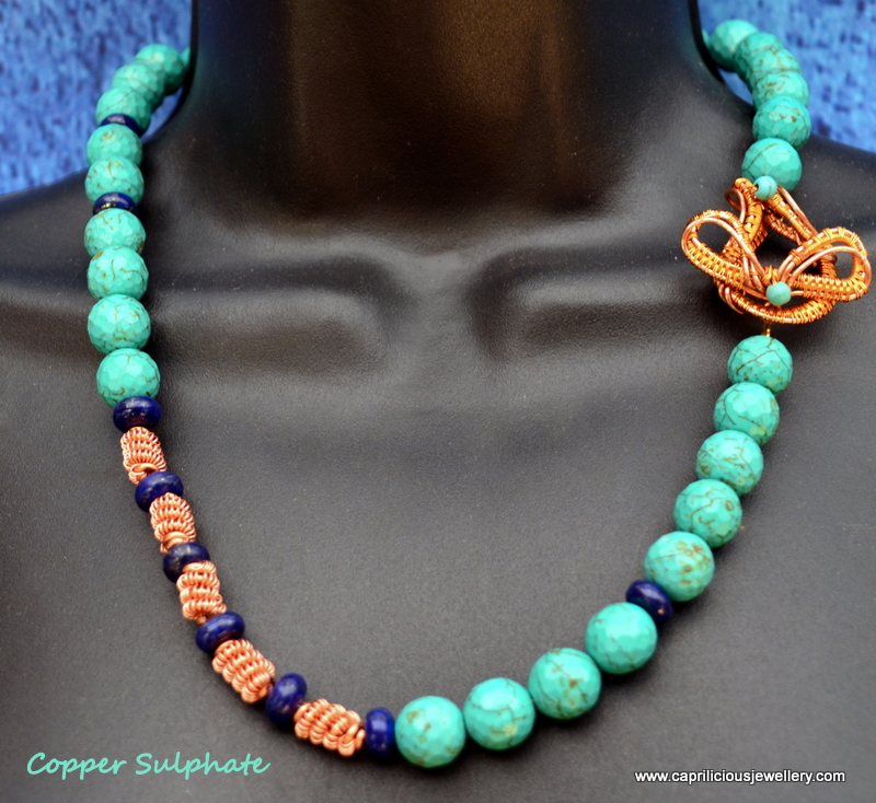 Turquoise, lapis and copper coiled wire beads with a handmade clasp by Caprilicious Jewellery