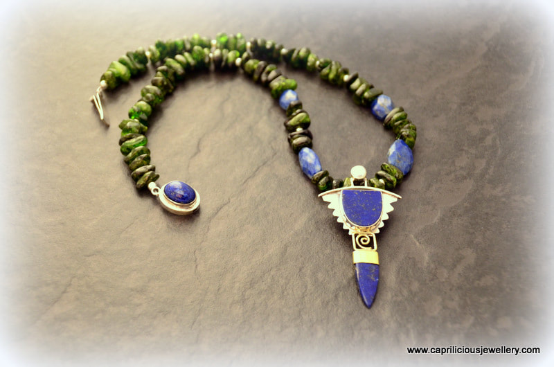 Sterling silver and lapis lazuli pendant on a chromium diopside nugget bead necklace by Caprilicious Jewellery