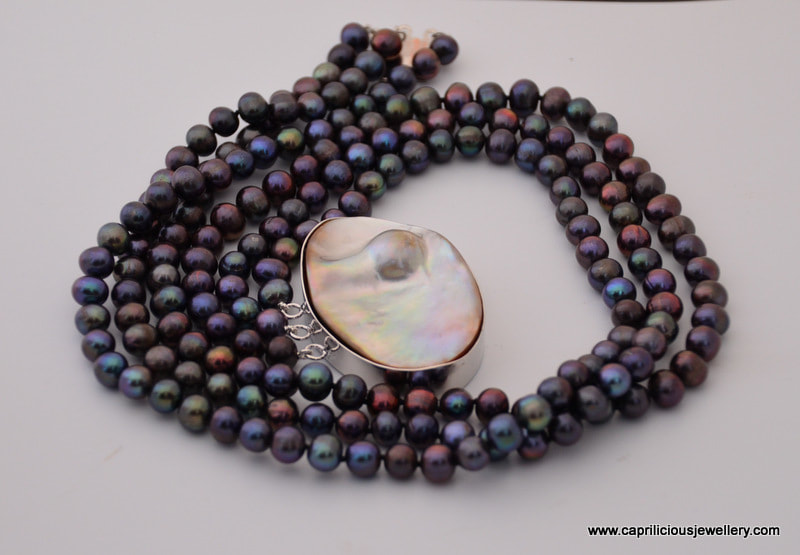 Blister pearl clasp and rainbow pearls in a multistrand necklace, Caprilicious Jewellery