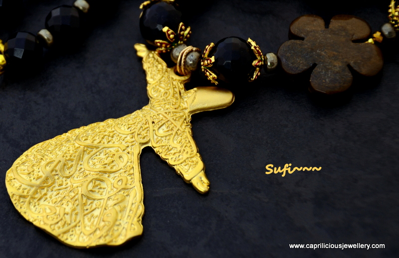 Sufi - a whirling dervish pendant on an onyx bead necklace by Caprilicious Jewellery