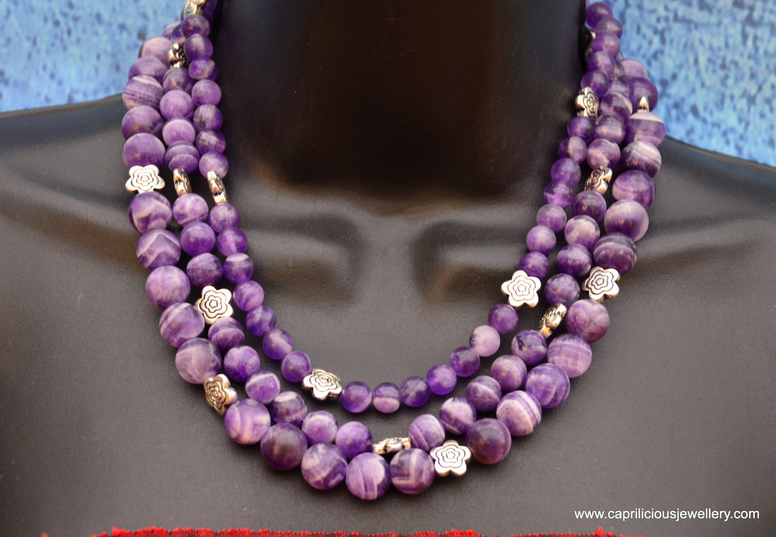 Three strand matte striate amethyst necklace with a resin rose clasp by Caprilicious Jewellery