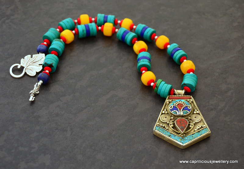 Nepalese pendant on a necklace of turquoise, coral, lapis and faux amber by Caprilicious Jewellery