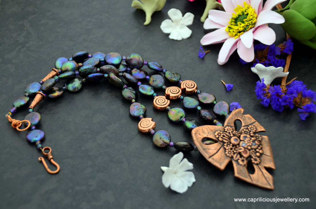 The Last Leaf - a copper clay leaf and rainbow dyed coin pearls in a statement necklace by Caprilicious Jewellery