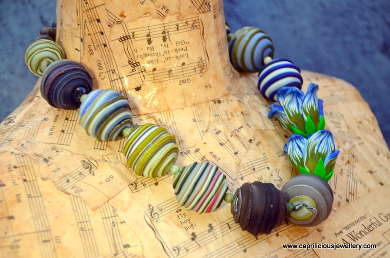 Polymer clay beads and flower necklace by Caprilicious Jewellery