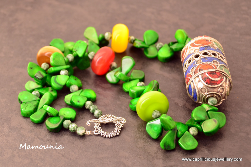 Mamounia - a Moroccan amulet, bamboo coral teardrop beads, cat's eye glass beads by Caprilicious Jewellery