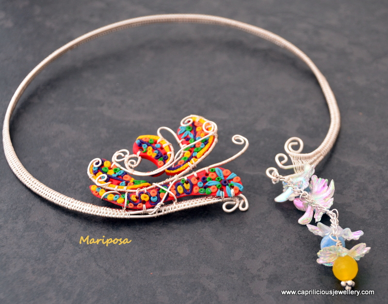 Mariposa - polymer clay and wire butterfly on a wire torque by Caprilicious Jewellery
