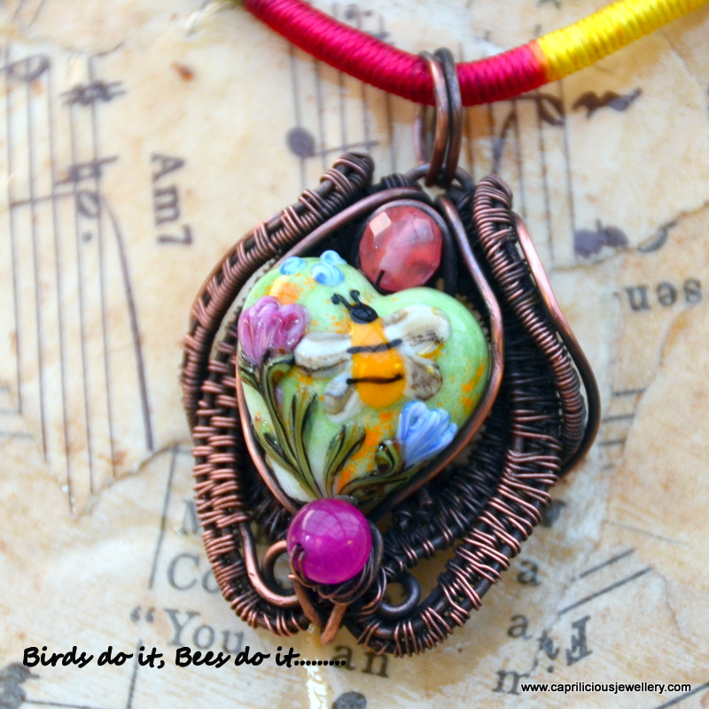 Birds Do it, Bees Do it - lampwork glass pendant set in wire by Caprilicious Jewellery