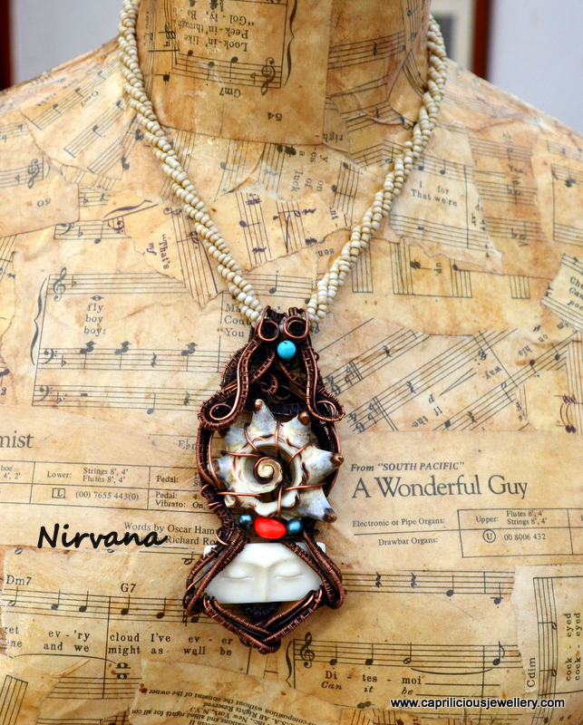 Nirvana - a hand carved bone face and slice of shell wrapped in copper wire by Caprilicious Jewellery
