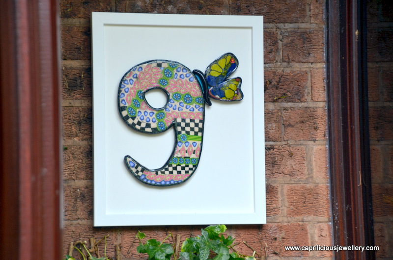 Polymer clay house number with a butterfly by Caprilicious Jewellery