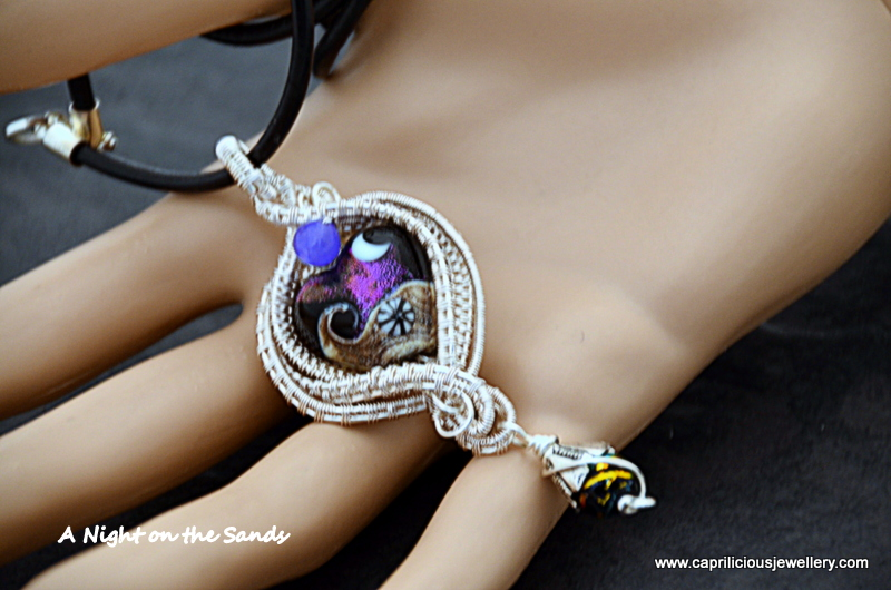 A Night on the Sands - lampwork glass pendant set in wire by Caprilicious Jewellery
