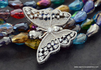 Bling, a butterfly and crystal necklace by Caprilicious Jewellery