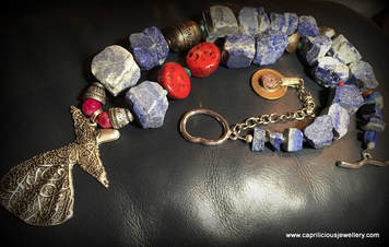 Sufi, Rumi and lapis lazuli and coral necklace by Caprilicious Jewellery