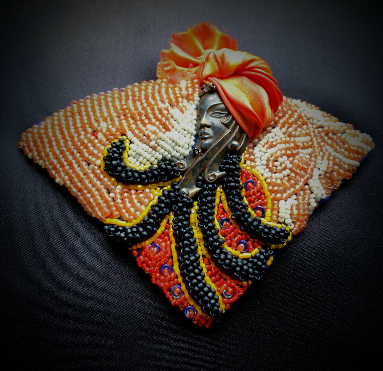 Bead Embroidery, afro caribbean art, Vintaj, dreadlocks, Shibori ribbon, face jewellery, pendant.